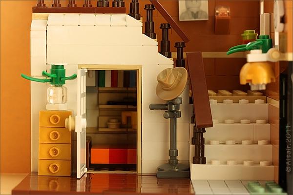 Как обустроить место под лестницей?